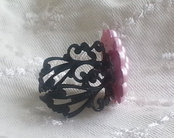 Pink pearl button ring on filigree