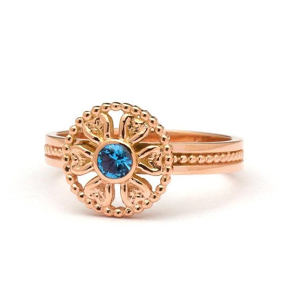 Artistic Flower Blue Topaz Engagement Ring in 14k Rose Gold