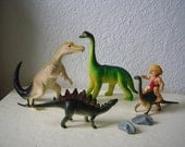 Dinosaur Playset, Includes four dinosaurs, caveman and two rocks