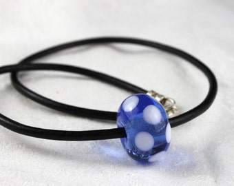 Lampworked Light Blue Glass Bead with White Dots, leather Rem, Sterling Silver Finish and Claps