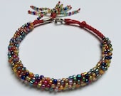 Beaded Kumihimo Bracelet- multicolor iridescent on red cord