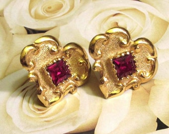 I <3 Paris. Stunning Christian Lacroix Heart earrings. Oversized 1980s gold clip with a sparkly red stone. Made in France.
