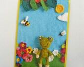 Cute crochet frog in knitted garden card
