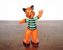 Vintage E. Rosen or Rosbro waving cat, 1950s hard plastic styrene Halloween candy container, orange, black, green striped shirt, decoration