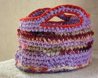 Scrapy rag crochet basket upcycled fabric scraps and plastic yarn pink purple red crochet bowl with two handles