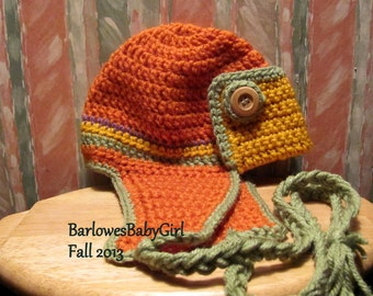 Buggs Crochet Bomber/Aviator Hat in Pumpkin, fern, Gold, and Orchard w/ Wood Button Accents
