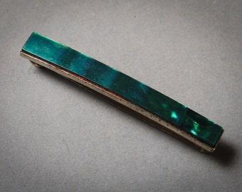 Vintage metal tie bar clip with plastic.