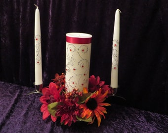 Three Piece Unity Candle set made with a swirl design of rhinestones with deep red ribbon and garnet gemstones