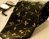 Black gothic wedding tie with gold leaves. Black and gold mens tie. Gold stitches on mens tie. Rear jacquard with gold tie.