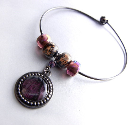 Black bangle bracelet with picture frame charm with glass beads in mauve purple gold