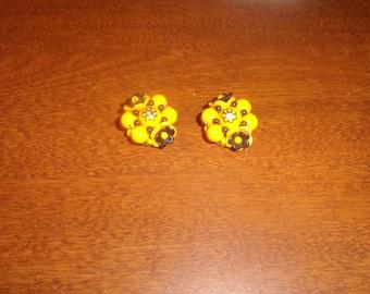 vintage clip on earrings orange black bead cluster