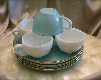 Blue milk glass plates with blue and white milk glass cups, blue milk glass snack plates and cups