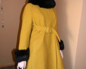 1950s mustard  swing coat. From MILTONS .Most popular color at the golden globes  Fine Virgin Wool .Black fur faux trim