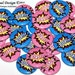 "Comic Book Superhero Gender Reveal Party Set of 24 Buttons Baby Shower Favor 1"" or 1.5"" or 2.25"" Pin Back Button Pink Blue 1"" Magnets"