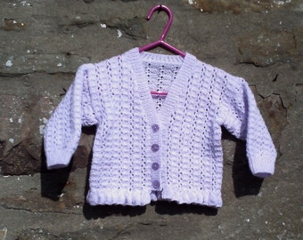 "Hand knitted baby girls lilac lacy cardigan. 20"" chest"