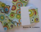 10 small envelopes/ circles with 10 blank note cards