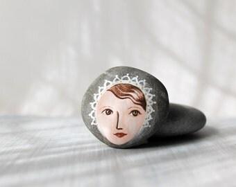 Painted stone. painted pebble. Beach pebbles art.