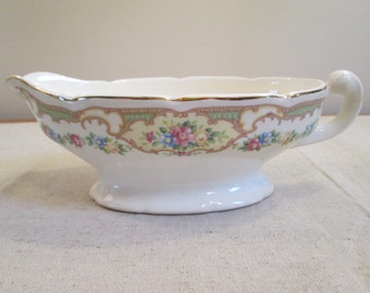 Mildred Mt. Clemens pottery Co. pattern gravy boat USA pottery shabby pink blue yellow roses light green background vintage gravy boat