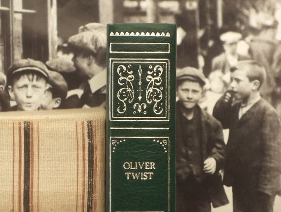 Oliver Twist book classic fiction by Charles Dickens bound in dark green faux leather