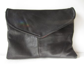 one of a kind black leather clutch with colored interior