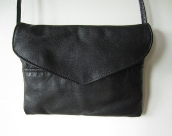 small black leather purse with skinny strap