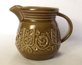 Shorter pottery brown creamer