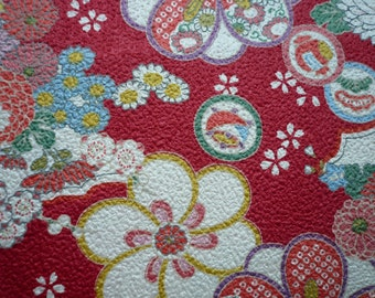 Tissu japonais motifs fleurs fond gaufré rouge- 50 cm