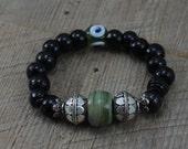 Gypsy Bohemian Bracelet Handmade Green Evil Eye and Black Crow Beads with Bali Style Silver Beads