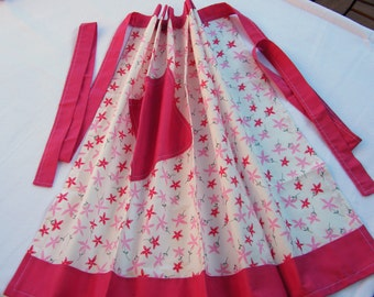 Apron. pretty in pink, Half apron made using a white fabric with pale pink and cerise stars on it and a cerise plain fabric.