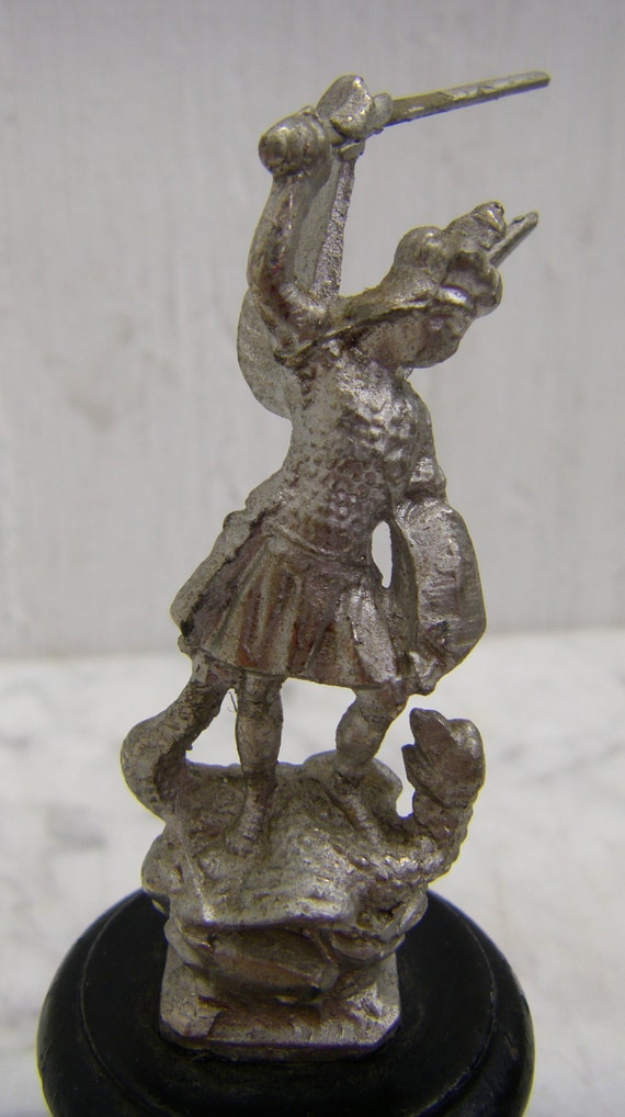 antique statue of st michael from mont st michel in normandy