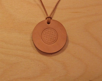 Leather necklace with embossed celtic knot