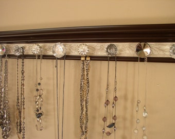 "Brown jewelry organizer. This wall necklace rack has 9 decorative knobs on a champagne embossed background 26"" Closet organization storage"
