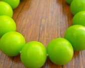 14mm Resin beads solid lime green 1 x strand of 30