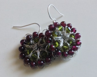 Crochet wire earrings with olive green Swarovski crystals and garnet beads