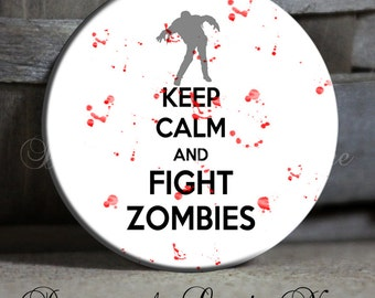 """Keep Calm and Fight ZOMBIES with Blood Splatter on White with Zombie Black White Red Quote - 1.5"""" Pinback Button, Magnet, Key Chain"""