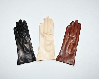 A set of three different colors autumn gloves of  Italian kid-skin.