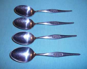 "Four (4), Stainless, 6"" Teaspoons, from NASCO, in the Black Rose Patern."