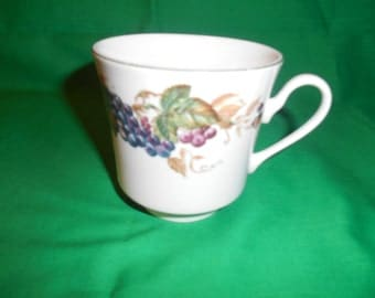 One (1), Footed Tea Cup, from American Atelier, in the Bountiful Harvest 5731 Pattern.