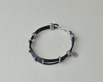 Black leather bracelet with sterling silver Aum charm. (B10012)
