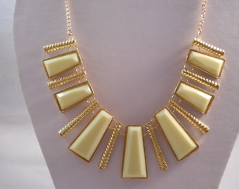 Gold Tone Chain Bib Necklace with Ecru and Gold Tone Pendants