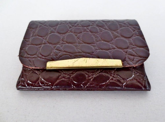 Small bare essentials croc embossed mahogany leather wallet.