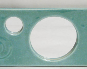 Peek-a-boo slim ceramic wall mirror in robin's egg blue