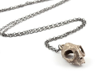 Cat Skull Necklace in steel - A steel cat skull necklace on a gunmetal chain or a choker to adorn your neck