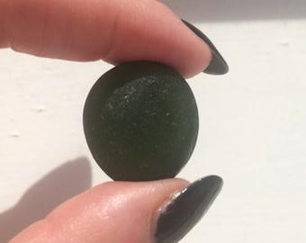 Sea glass: Deep bottle green sea glass piece. A very good size with a deep jewel tone