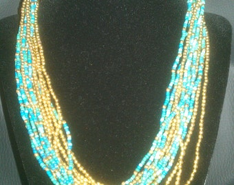 Vintage Costume Teal, Turquoise, and Gold Beaded Necklace with Larger Gold Beads at Clasp