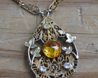 Beautiful antique gold tone edwardian art deco floral ivy filigree necklace with yellow and white rhinestones