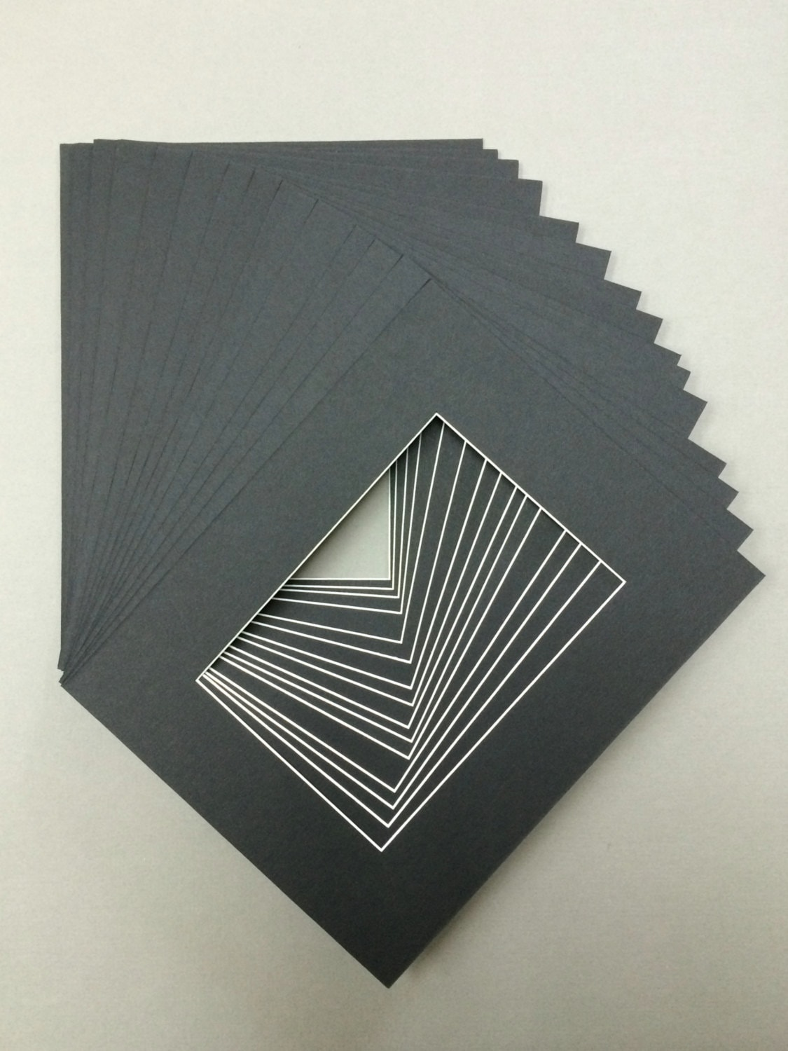 Package Of 20 8x10 Black Mats With White Core Bevel Cut