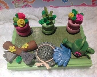 Gardener,flowers,business card holder,garden,planting,nursery owner,plant shop,landscaping, cell phone holder  handmade polymer clay