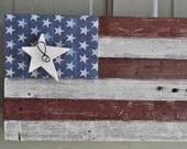 Fourth of July American flag rustic made of recycled wood with white wooden star on wire