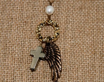 Bridget Necklace: Pyrite cross, halo and angel wing on antique brass necklace with freshwater pearl accent